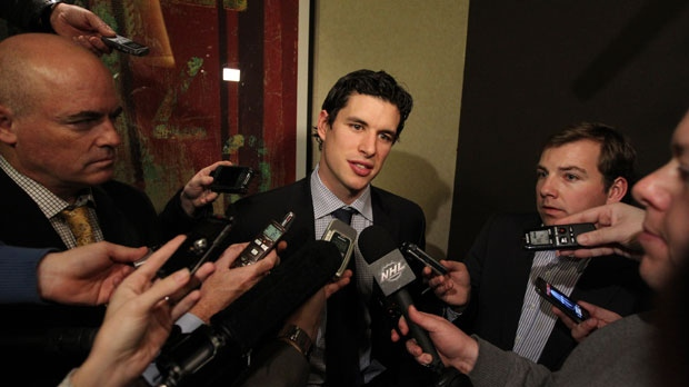 Pittsburgh Penguins' Sidney Crosby speaks to reporters on Thursday, Dec. 6, 2012 in New York. (AP Photo/Mary Altaffer)