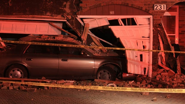 A car crashed into a house on Raymerville Drive in Markham early Friday, Dec. 7, 2012. (Tom Stefanac/CP24)