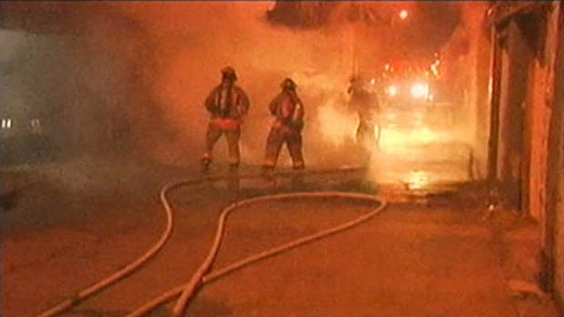 Firefighters battle a blaze on Bathurst Street early Friday, Dec. 7, 2012.