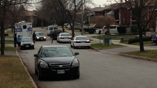 Police cars are parked outside a home where a man was fatally shot on Corkstone Glade in Mississauga on Friday, Dec. 7, 2012. (Cam Woolley/CP24)