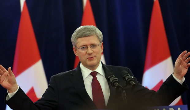 Prime Minister Stephen Harper delivers a statement regarding the federal government review of the $15.1-billion takeover of Nexen Inc. by China's CNOOC Ltd. and the $6-billion takeover of Progress by Malaysia's Petronas in Ottawa on Friday December 7, 2012. (The Canadian Press/Fred Chartrand)