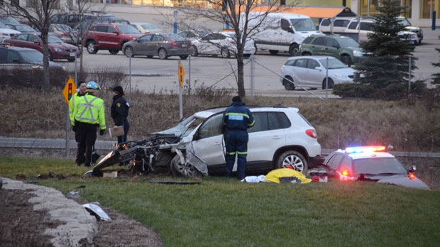 Police attend the scene of a fatal collision at Highway 401 and Winston Churchill Boulevard in Mississauga Sunday, December, 9, 2012. (CP24/ Andrew Collins)
