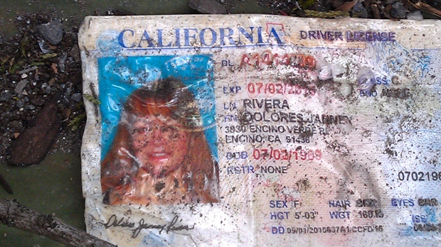 A California driver's license bearing the name of Jenni Rivera sits on the ground at the site of a plane crash near Iturbide, Mexico on Sunday Dec. 9, 2012. (AP Photo)