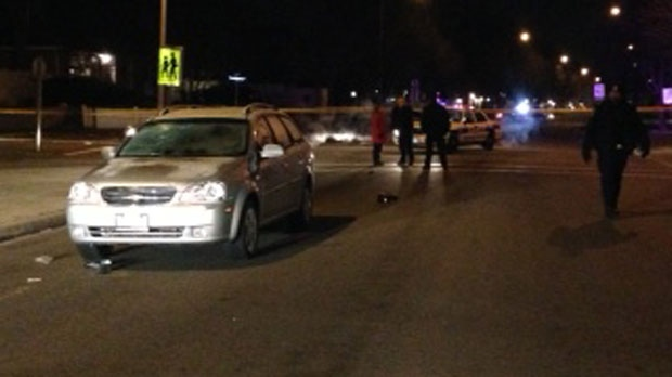 Police tape is visible in this photo after a woman and her two children were struck by a vehicle in Mississauga on Tuesday, Dec. 11, 2012. (CP24/Jackie Crandles)