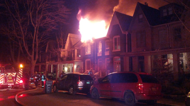 Firefighters battle an early-morning house fire on Follis Avenue in Toronto on Wednesday, Dec. 12, 2012. (Tom Stefanac/CP24)