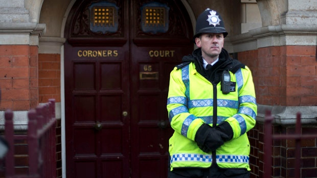 A policeman stands on duty outside Westminster Coroner's Court, where the initial inquest into nurse Jacintha Saldanha's death was held, in London on Thursday, Dec. 13, 2012. (AP Photo/Alastair Grant)