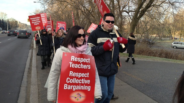 Public elementary school teachers walk a picket line in front of the York Region District School Board's head office in Aurora on Thursday, Dec. 13, 2012. (Mathew Reid/CP24)