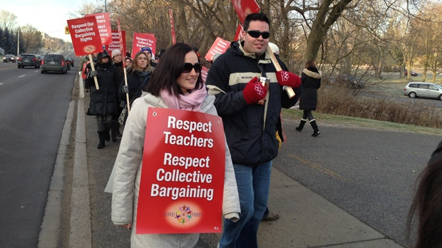York Region teachers carry picket signs during a one-day strike Thursday, Dec. 13, 2012. (CP24/ Cristina Tenaglia)