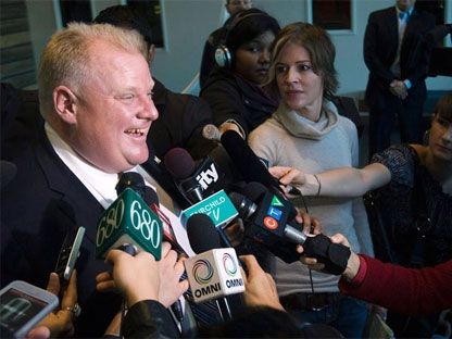 Rob Ford, left, talks with the media after speaking on air at Talk Radio AM 640 in Toronto on Oct. 27, 2010. (Nathan Denette / THE CANADIAN PRESS)