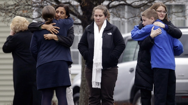 Mourners gather outside the funeral service for Sandy Hook Elementary School shooting victim Jack Pinto, 6, on Monday, Dec. 17, 2012, in Newtown, Conn. (AP Photo/David Goldman)