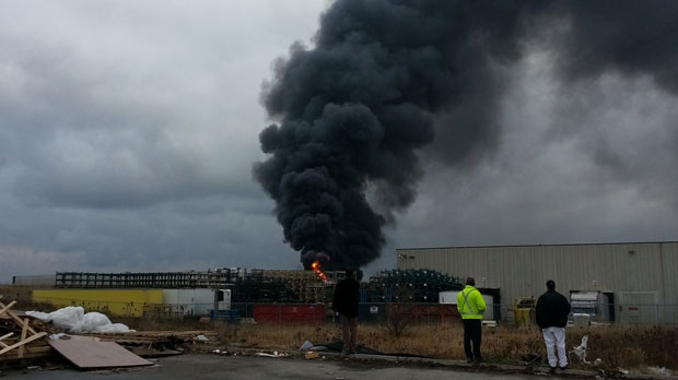 Onlookers watch smoke rise in this picture of a warehouse fire in Brampton on Monday, Dec. 17, 2012. (Jonathan Samms)