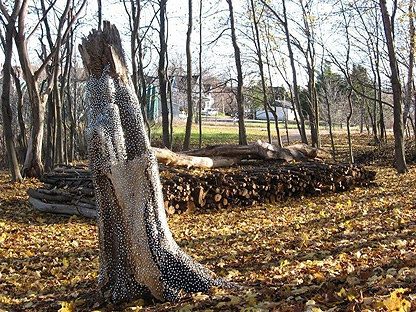 """The sculpture """"Deadwood Sleep"""" is shown in this undated photo in Sackville, N.B., released on Monday Nov. 29, 2010. A New Brunswick logger is unrepentant after beginning to dismantle a woodpile that turned out to be a sculpture. Ron Fahey of Sackville said Monday he was granted permission in August from Mount Allison University to take the logs stacked in an area behind the president's residence alongside a water fowl park in the town. (THE CANADIAN PRESS/HO, Paul Griffin)"""