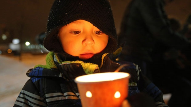 Lucas Gamez, 4, holds a candle at a vigil in memory of six year-old Ana Marquez-Greene, a victim of the mass shooting in Newtown, Conn., on Monday, Dec. 17, 2012. (The Canadian Press/Trevor Hagan)