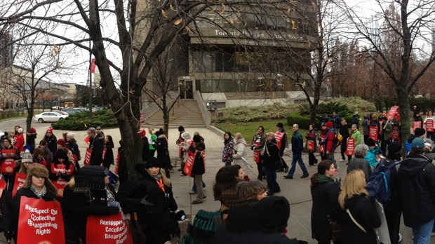Teachers picket outside the Toronto District School Board's head office during a one-day strike Tuesday, Dec. 18, 2012. (Mathew Reid/CP24)