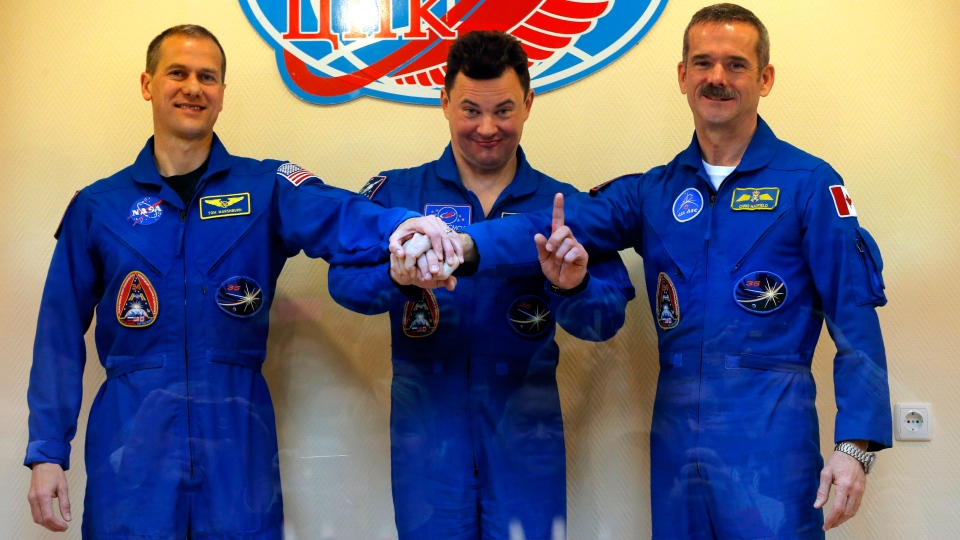 U.S. astronaut Thomas Marshburn, left, Russian cosmonaut Roman Romanenko, center, and Canadian astronaut Chris Hadfield, pose for the media after a news conference in the Russian leased Baikonur cosmodrome, Kazakhstan, Tuesday, Dec. 18, 2012. (AP / Dmitry Lovetsky)