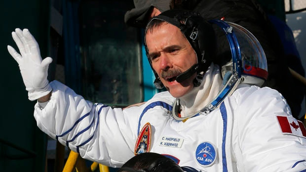 Canadian astronaut Chris Hadfield, a crew member of the mission to the International Space Station, gestures prior to the launch of the Soyuz-FG rocket at the Russian-leased Baikonur cosmodrome in Kazakhstan, Wednesday, Dec. 19, 2012. (AP Photo/Dmitry Lovetsky, Pool)