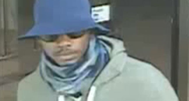One of three suspects wanted in connection with an armed robbery at a North York cellphone store is shown in this surveillance camera image.