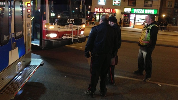 Police are seen in this photo after a female pedestrian was stuck by a bus at Yonge Street and Finch Avenue on Wednesday, Dec. 19. 2012. (CP24/Kyle Surowicz)
