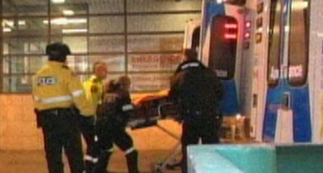 One of the victims in a double stabbing on Bleecker Street is transported to hospital on Thursday afternoon. (CP24)