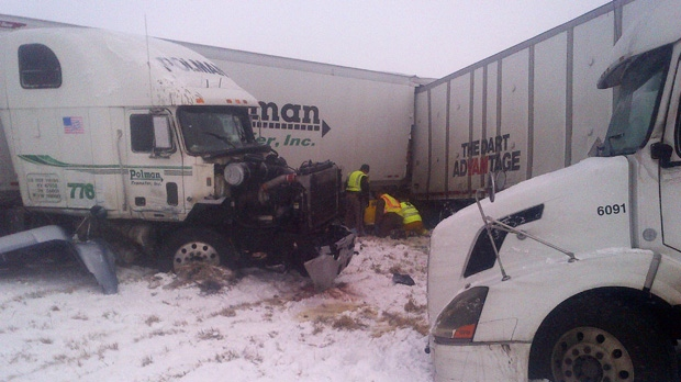 This photo provided by the Iowa State Patrol shows the scene of a 25-vehicle pileup that killed two people and injured several others Thursday, Dec. 20, 2012, on Interstate 35, north of Des Moines, Iowa. (AP Photo/Iowa State Patrol)