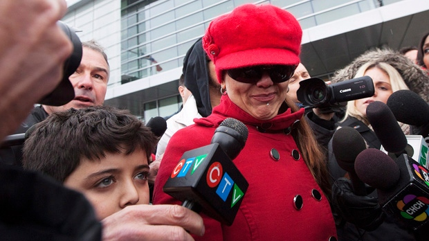 Yasmin Nakhuda and her 11-year-old son leave an Oshawa courthouse on Friday, Dec. 21, 2012, after she was denied temporary custody of her famed monkey Darwin. (The Canadian Press/Michelle Siu)