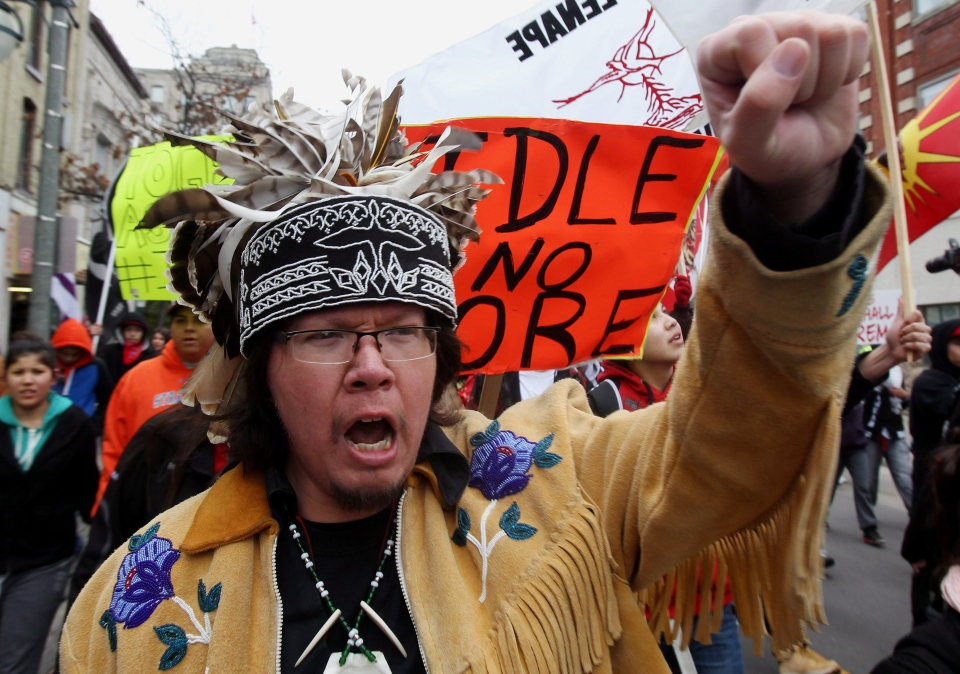 Lot?t Honyust, from the Oneida Frist Nation, raises his fist during a protest in London, Ont. on Wednesday, December 19, 2012.  (Dave Chidley/ THE CANADIAN PRESS)