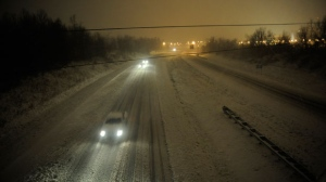 Motorists travel slowly on a snow-covered Interstate 24 during a winter storm Wednesday, December 26, 2012, in Paducah, Ky.  (AP /Stephen Lance Dennee)