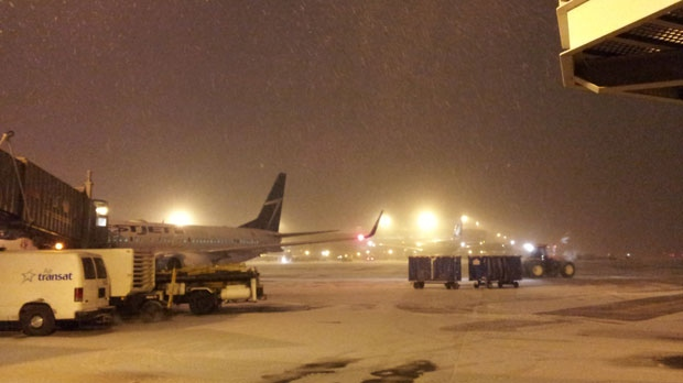 Snow is seen on the ground at Pearson International Airport late Wednesday night. An early-winter storm blanketed the airport with 10 cm of snow overnight.