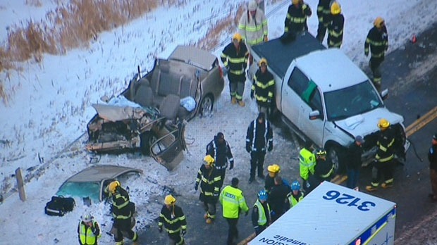 Emergency workers are seen in this photo following a serious collision on Mt. Albert Road, the second of the day, in East Gwillimbury on Thursday, Dec. 27, 2012. (CP24/Cristina Tenaglia)