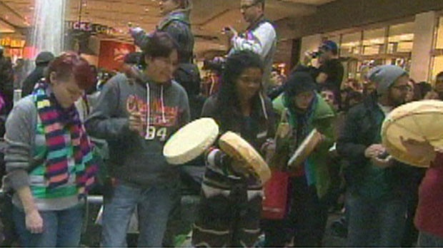 Idle No More protesters take part in a demonstration at Toronto's Eaton Centre Sunday, December 30, 2012 in order to draw attention to what they see as the dire situation of First Nations peoples in Canada.