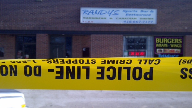 Police tape surrounds a Keele Street sports bar where a man was fatally stabbed early Tuesday, Jan. 1, 2013. (George Lagogianes/CP24)