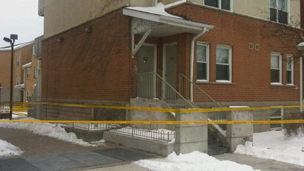 Police tape surrounds a townhouse complex on Colonial Drive in Mississauga as officers investigate a homicide Wednesday, Jan. 2, 2013. (Cam Woolley/CP24)