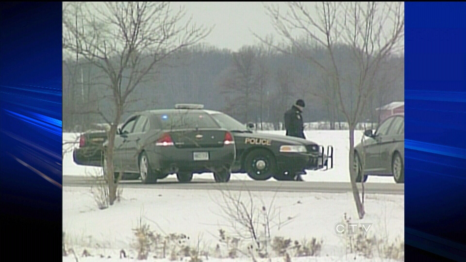 Police investigate after a woman's body was found at a woodlot in Sarnia, Ont., on Thursday, Jan. 3, 2013.