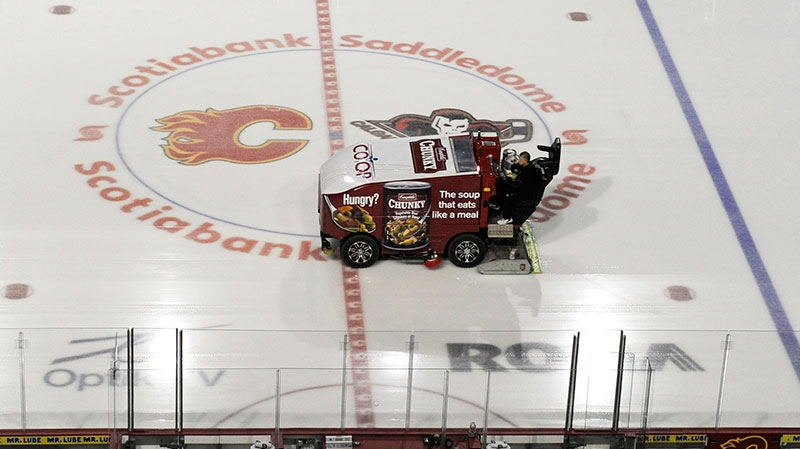 The ice surface is cleaned at an empty Scotiabank Saddledome in Calgary, Alta., home of the NHL's Calgary Flames, on Sunday, Jan. 6, 2013. (Larry MacDougal / THE CANADIAN PRESS)