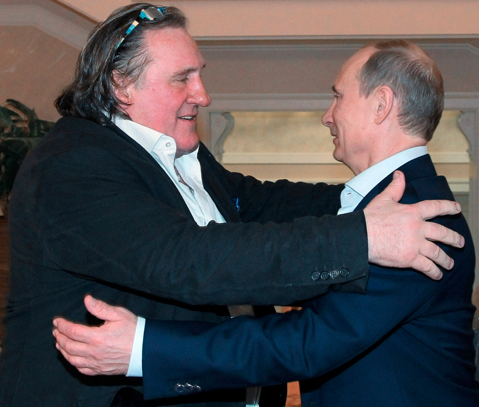 French actor Gerard Depardieu, left, greets Russian President Vladimir Putin after his arrival late Saturday, Jan. 5, 2013, at the president's residence in Sochi, the host city of the 2014 Winter Olympics. (AP Photo)