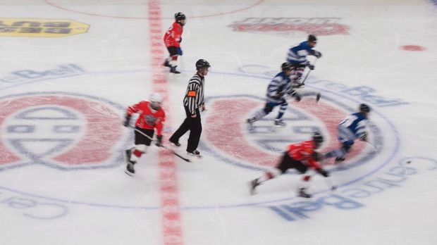 Young hockey players skate across a Montreal Canadiens logo at the Bell Centre in Montreal on Sunday, Jan. 6, 2013, on the day when NHL and the NHLPA reached a tentative deal to end the NHL lockout. (The Canadian Press/Graham Hughes)