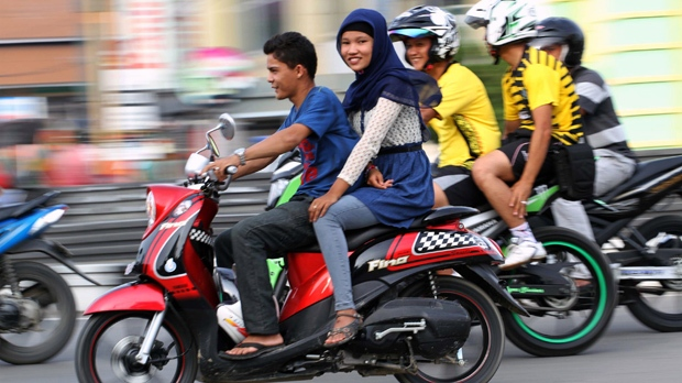Aceh Indonesia law ban women straddling motorbikes