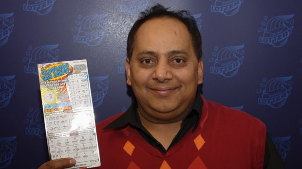 This undated photo provided by the Illinois Lottery shows Urooj Khan, 46, of Chicago's West Rogers Park neighborhood, posing with a winning lottery ticket. (AP Photo/Illinois Lottery)