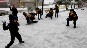 Syrian refugee children have a snowball fight in the mountain town of Bhamdoun, Lebanon on Wednesday, Jan. 9, 2013. (AP Photo/Bilal Hussein)