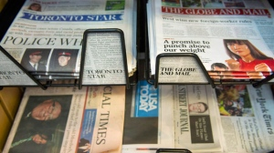 Stacks of The Globe and Mail and the Toronto Star sit in a news stand in Toronto on April 26, 2012. (The Canadian Press/Nathan Denette)