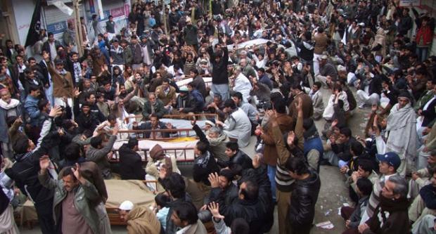 Pakistan, dead, bury, protest, explosions