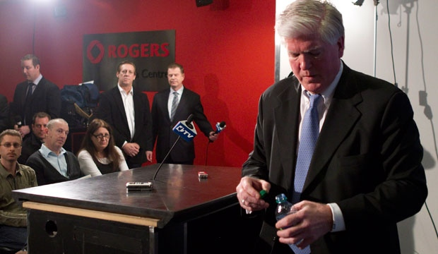 Former Toronto Maple Leafs General Manager Brian Burke leaves a news conference in Toronto on Saturday, Jan. 12, 2013. (The Canadian Press/Chris Young)