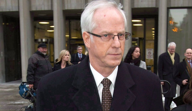 Former Nortel Networks chief executive Frank Dunn leaves court in Toronto on Monday, Jan. 16, 2012. (The Canadian Press/Frank Gunn)