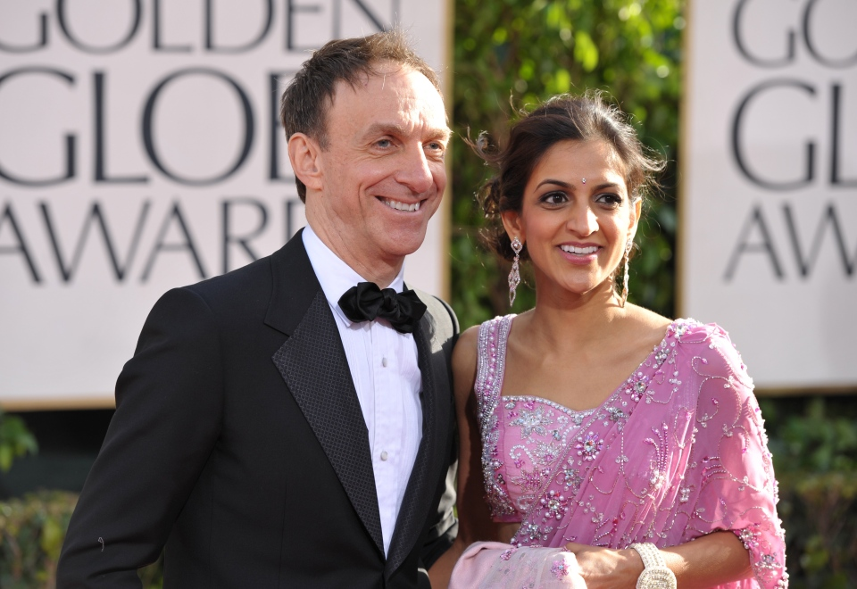 Mychael Danna, left, and Aparna Danna arrive at the 70th Annual Golden Globe Awards at the Beverly Hilton Hotel in Beverly Hills, Calif., Sunday Jan. 13, 2013.