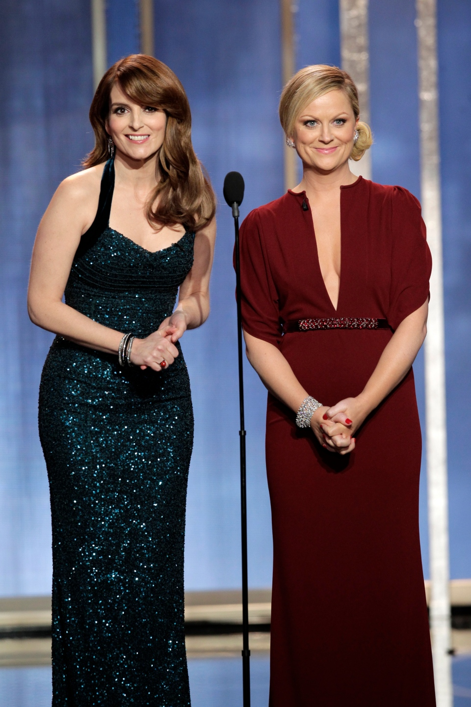 This image released by NBC shows co-host Tina Fey, left, and Amy Poehler on stage during the 70th Annual Golden Globe Awards held at the Beverly Hilton Hotel on Sunday, Jan. 13, 2013, in Beverly Hills, Calif. (AP/ Handout)