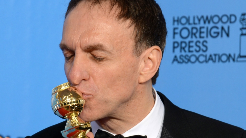 """Mychael Danna poses with the award for best original score in a motion picture for """"Life of Pi"""" backstage at the 70th Annual Golden Globe Awards at the Beverly Hilton Hotel in Beverly Hills, Calif., Sunday Jan. 13, 2013. (Jordan Strauss / Invision)"""