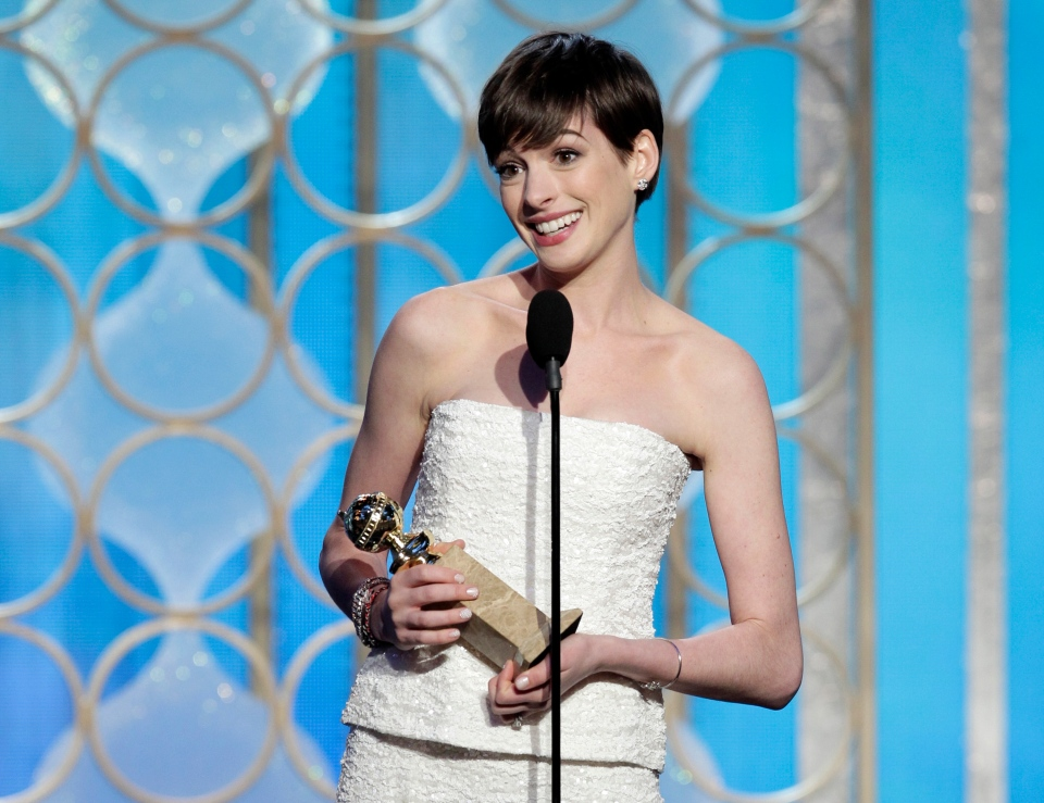 "Anne Hathaway with her award for best supporting actress in a motion picture for her role in ""Les Miserables"" during the 70th Annual Golden Globe Awards at the Beverly Hilton Hotel in Beverly Hills, Calif., Jan. 13, 2013."