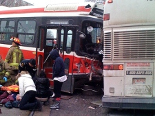 Emergency crews attend to victims after a TTC streetcar crashed with a Greyhound bus on Thursday Dec. 16, 2010. (CP24/MyBreakingNews)