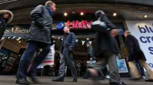 People walk outside a branch of HMV music store on Oxford Street in central London on Tuesday, Jan. 15, 2013. (AP Photo/Lefteris Pitarakis)
