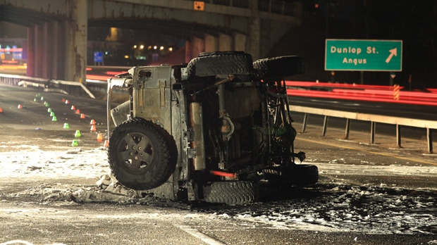 A 43-year-old woman was killed in a fiery crash on Highway 400 in Barrie early Wednesday, Jan. 16, 2013. (Tom Stefanac/CP24)